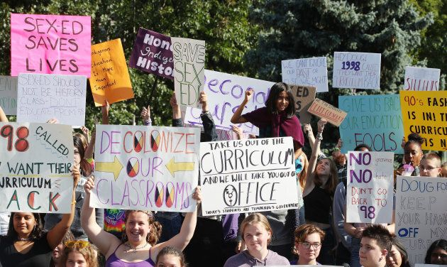 Over 100 students stage a sit-in on the lawn at Queen's Park in Toronto to follow up the #WeTheStudentsDoNotConsent walkout, Sept. 23, 2018.