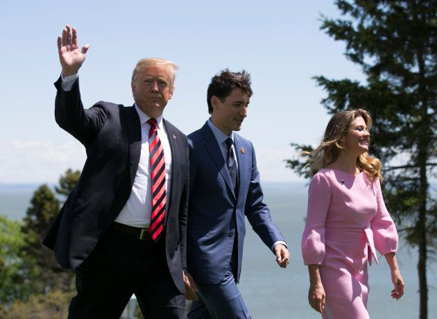 U.S. President Donald Trump walks with Prime Minister Justin Trudeau and his wife Sophie Gregoire Trudeau...