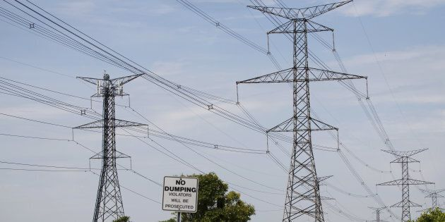 Power lines run through Hydro One Ltd. transmission towers in Toronto on July 12,