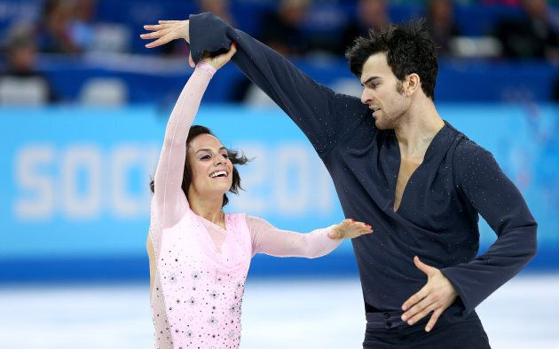 Eric Radford and Meagan Duhamel skate for Canada in the Sochi 2014 Winter Olympics on Feb. 11, 2014 in...