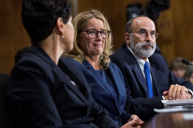 Dr. Christine Blasey Ford, flanked by attorneys Debra Katz and Michael Bromwich, during the hearing on...