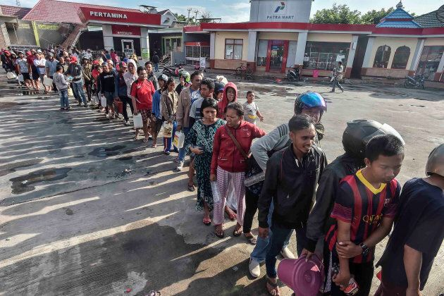 People line up for fuel at a gas station on Sunday in this photo taken by Antara