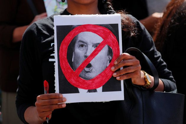 A member of a protest outside Los Angeles City Hall against the Senate Judiciary committee's vote on...