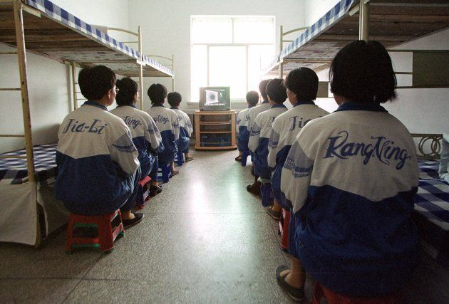 In this May 22, 2001 file photo, Falun Gong practitioners take part in deprogamming efforts enforced at the Masanjia reeducation-through-labour camp in northeast China's Liaoning province.