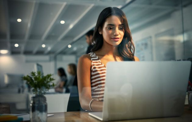 Shot of a businesswoman using a laptop during a late shift at