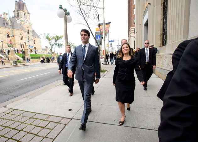 Trudeau and Freeland make their way to the press conference on the USMCA on Oct. 1,