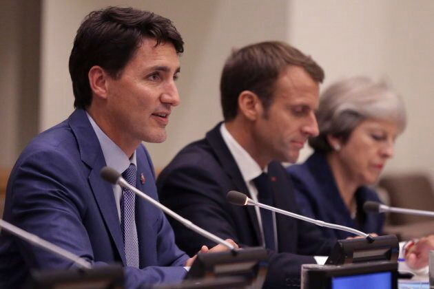 Prime Minister Justin Trudeau speaks alongside French President, Emmanuel Macron, center, and Britain's Prime Minister Theresa May during a Girl Education event at U.N. headquarters during the United Nations General Assembly on Sept. 25, 2018.