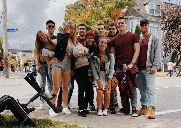Allie Mousseau-Dempsey, front centre in jean jacket, and Andy Andretta, far right in grey sweater, were at the Panda Game with their friends Saturday when they ran into Mayor Jim Watson.