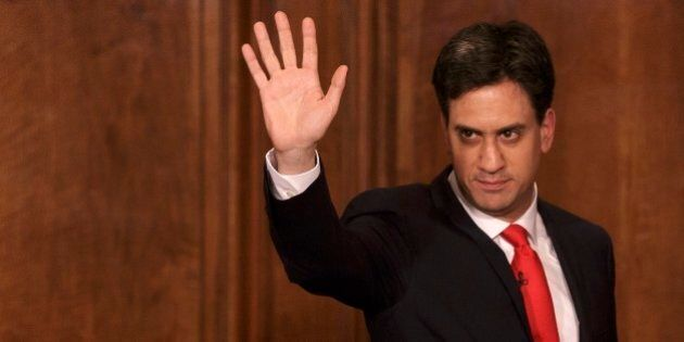 Britain's Labour Party leader Ed Miliband waves as he leaves after delivering his resignation at a press...