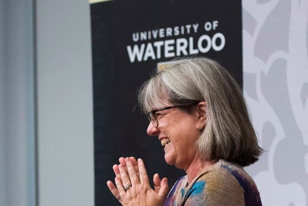 Noble Prize winner Donna Strickland smiles as she receives a standing ovation during a press conference...