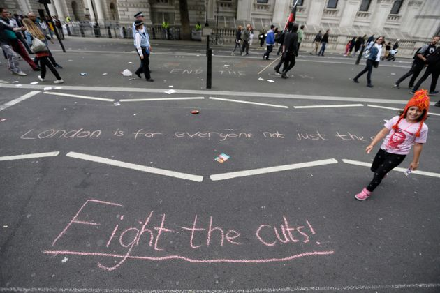 A protest against the Tory government and its austerity policies in London, England on June 20,
