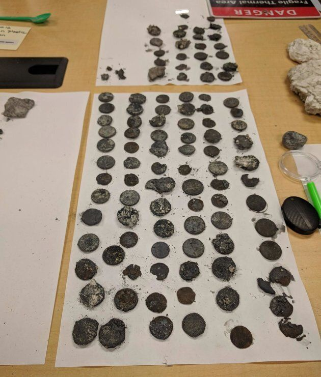 A closer look at some of the coins found near the geyser's vent.