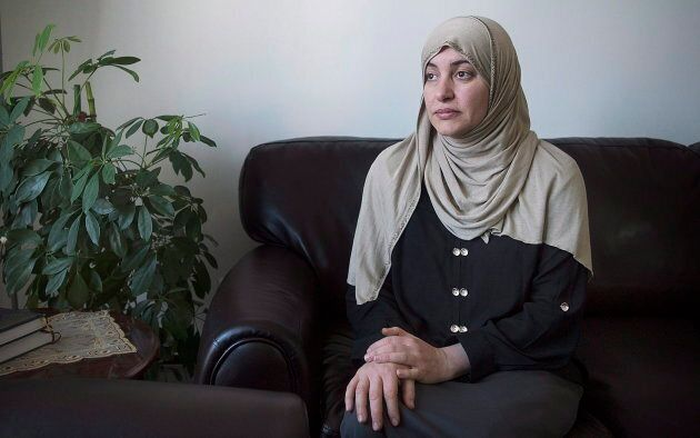 Wearing the Hijab when she went to court, Rania El-Alloul poses for a photograph at her home in Montreal...