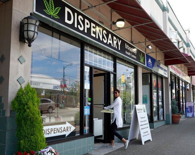 A woman walks into the Erbachay Health Centre Dispensary on Granville Street June 20, 2018 in