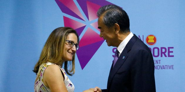 Foreign Minister Chrystia Freeland and China's foreign minister, Wang Yi, shake hands during a bilateral...
