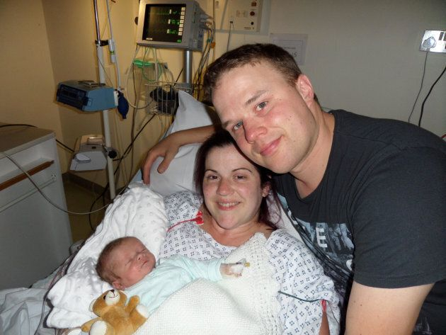 Rob Crussell, with his wife Kate, and son Theo. Theo died shortly after he was