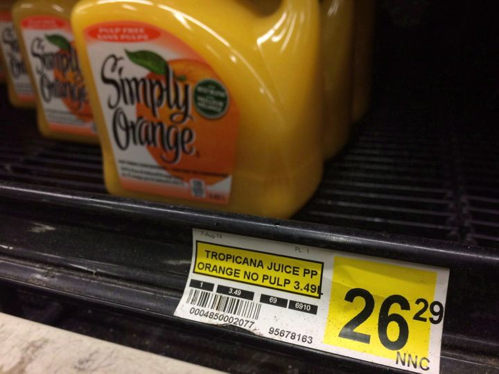 A price tag lists the price of a jug of orange juice at a grocery store in Iqaluit, Nunavut on Dec. 8, 2014.