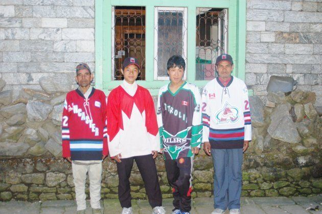 Mt. Everest porters pose for a photo in the first four jerseys Reeleder handed