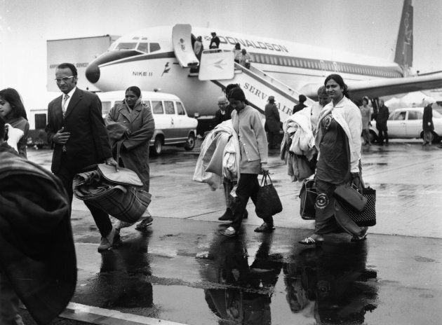 Ugandan Asians disembark the first of several specially chartered flights to Britain after military dictator Idi Amin implements a new regime expelling all Asians.