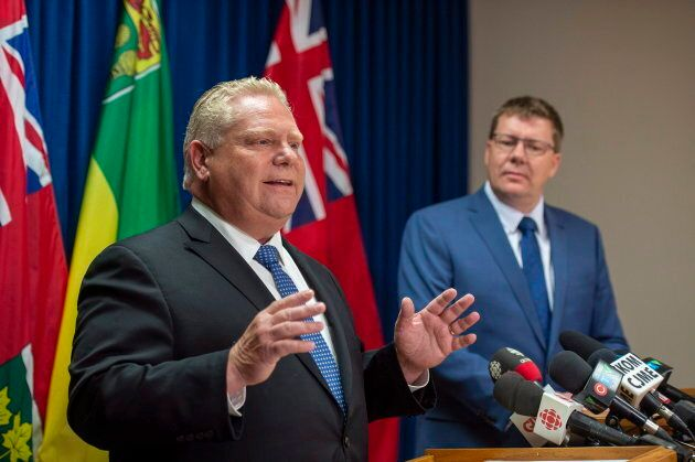 Ontario Premier Doug Ford speaks as Saskatchewan Premier Scott Moe listens during a media event in Saskatoon on Oct. 4, 2018.