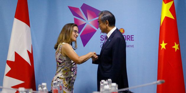 Foreign Affairs Minister Chrystia Freeland and China's Foreign Minister Wang Yi shake hands during a...
