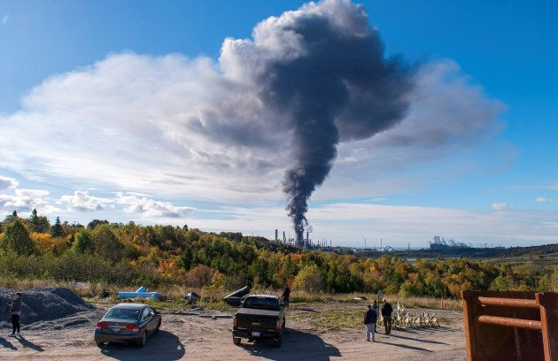 Smoke rises from the scene of a major explosion and fire at the Irving oil refinery in Saint John, Oct....