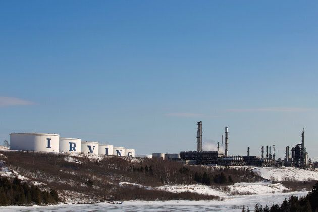Storage containers and the Irving Oil refinery are seen in Saint John, March 8,