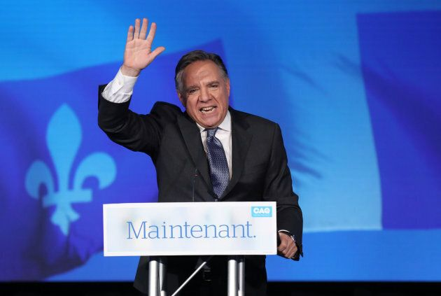 Coalition Avenir Quebec (CAQ) leader Francois Legault speaks to supporters from the podium in Quebec...