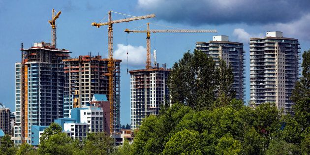 Residential towers under construction in New Westminster, B.C. Canada's housing market slowdown, which...