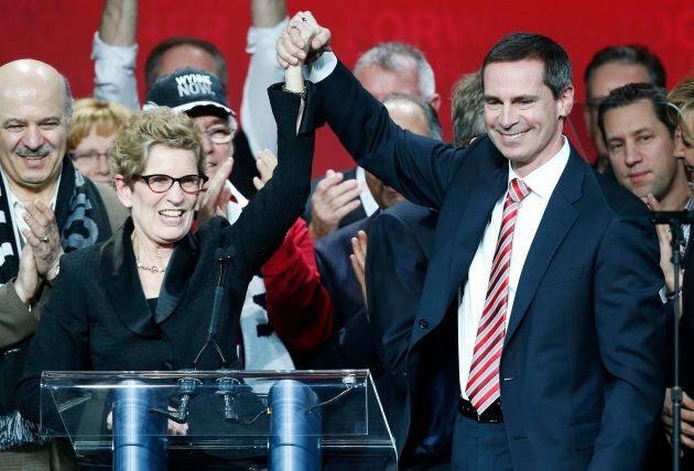 Kathleen Wynne is congratulated by outgoing Dalton McGuinty after winning the leadership bid to become the new premier of Ontario at the Ontario Liberal leadership convention in Toronto Jan. 26, 2013.
