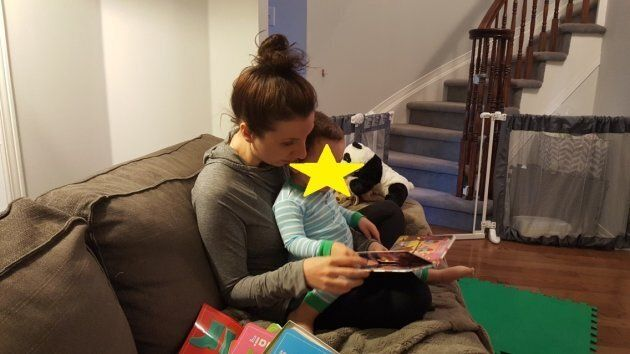 The author, a few weeks pregnant, stifling the overwhelming urge to barf so she can read to her son.