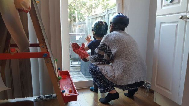 "The author and her son playing a game of ""oven mitts,"" which obviously requires helmets."