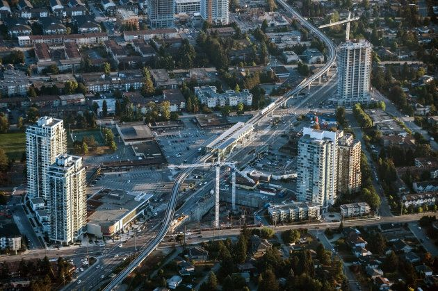 The Vancouver Skytrain line passes through condominiums under construction in Vancouver, British Columbia...