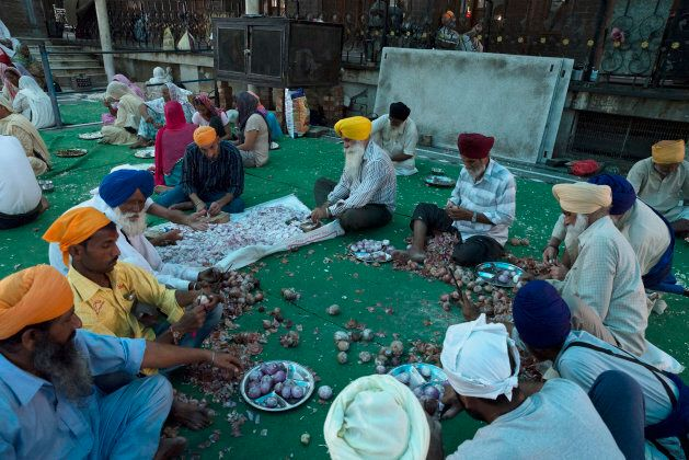 Devotees volunteer to prepare langar Sri Harmandir Sahib, the holiest temple of Sikhism.