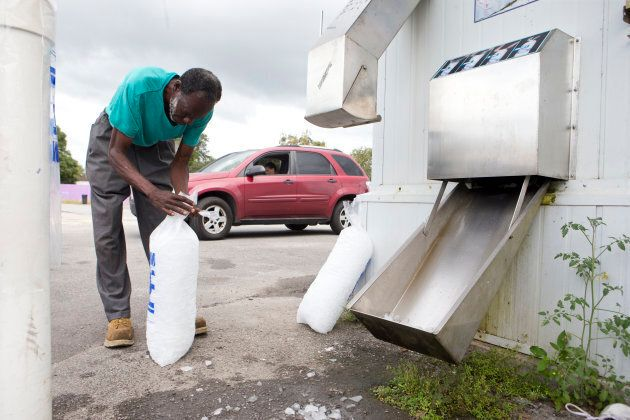 Willie Sanders bags ice for himself and his family in Panama City, Florida as Hurricane Michael approaches...