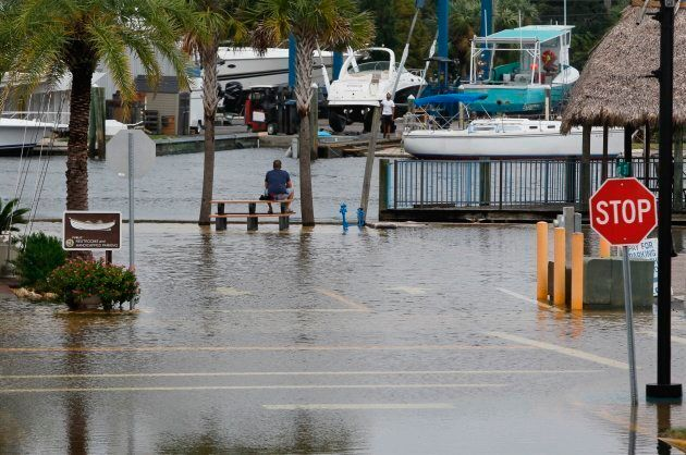High tide from offshore Hurricane Michael creeps up into the Sponge Docks in Tarpon Springs, Fla. on...