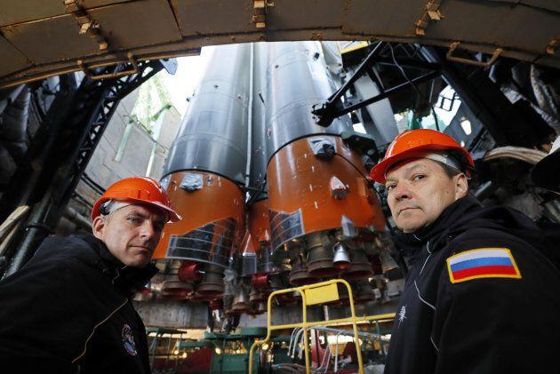 Backup crew members Roscosmos cosmonaut Оleg Kononenko (R) and CSA astronaut David Saint Jacques look...