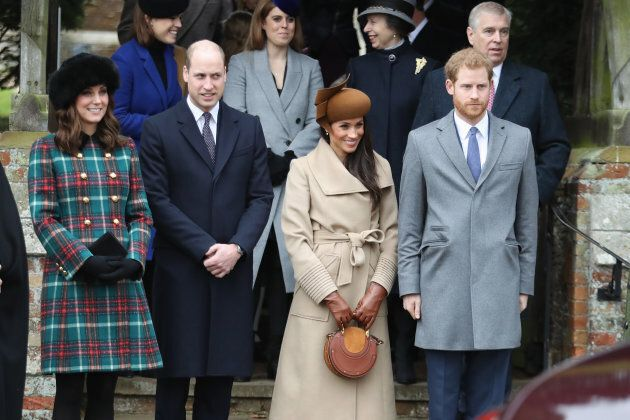 Princess Beatrice, Princess Eugenie, Princess Anne and Prince Andrew stand behind the Duke and Duchess...