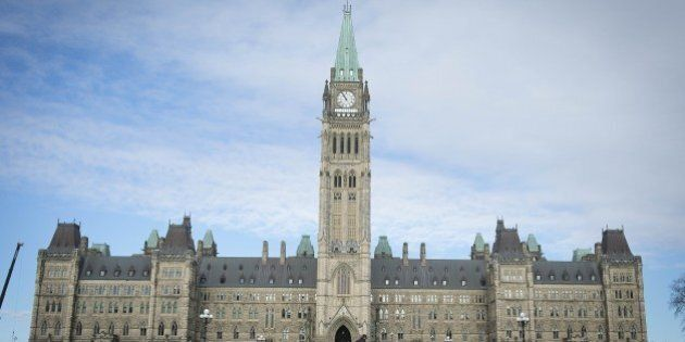 The Canadian Parliament is seen on October 23, 2014, in Ottawa, the day after multiple shootings in the...