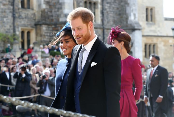 Prince Harry's outfit nicely complemented his wife's.