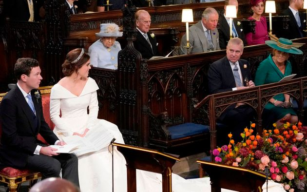You've got this: Princess Eugenie of York and Jack Brooksbank, left of aisle, look at her parents, Prince...