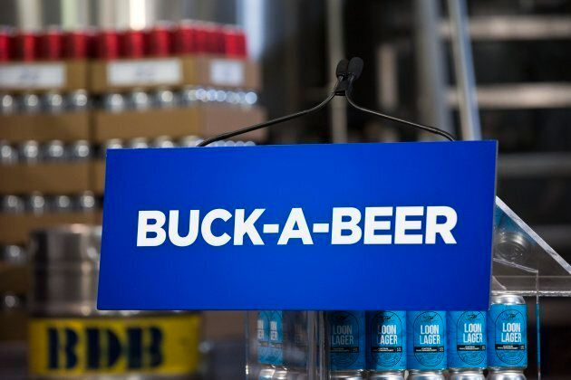 Cases of beer are stacked around the podium before Ontario Premier Doug Ford announces his buck-a-beer...