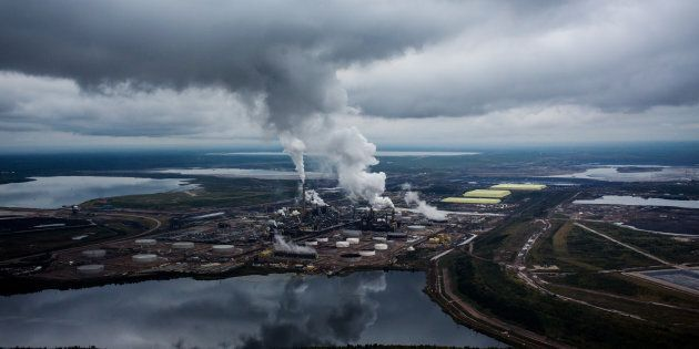 Steam rises from the Syncrude Canada Ltd. upgrader plant in the Athabasca oilsands near Fort McMurray,...