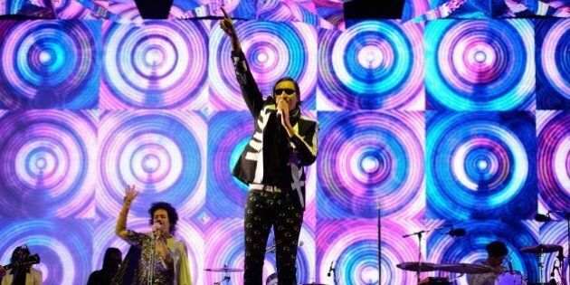Canadian band Arcade Fire headlines the Pyramid Stage on the first official day of the Glastonbury Festival of Music and Performing Arts on Worthy Farm in Somerset, south west England, on June 27, 2014. AFP PHOTO / LEON NEAL (Photo credit should read LEON NEAL/AFP/Getty Images)