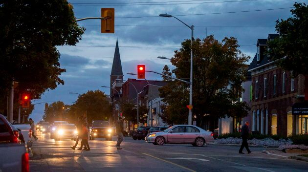 People walk in Smiths Falls, Ont. on Friday, Oct. 12,