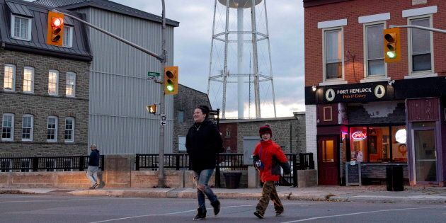 People walk in Smiths Falls, Ont., Fri. Oct. 12, 2018. The town is experiencing an economic renaissance...