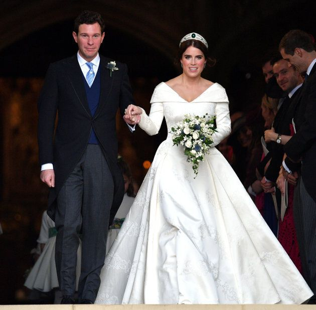 Jack Brooksbank and Princess Eugenie leave St George's Chapel after their wedding ceremony on Oct. 12,