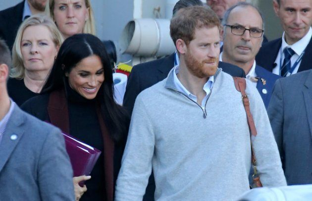 Prince Harry and Meghan Markle arrive at Sydney International Airport in Sydney, New South Wales.