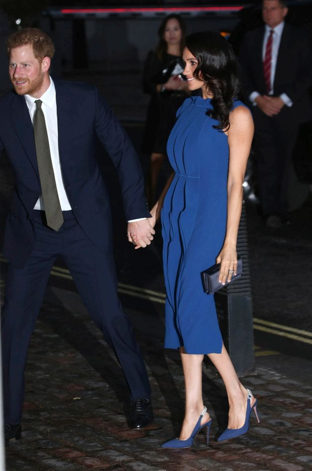Meghan and Harry at the 100 Days to Peace Gala in London. Was this dress a calculated choice to camouflage...