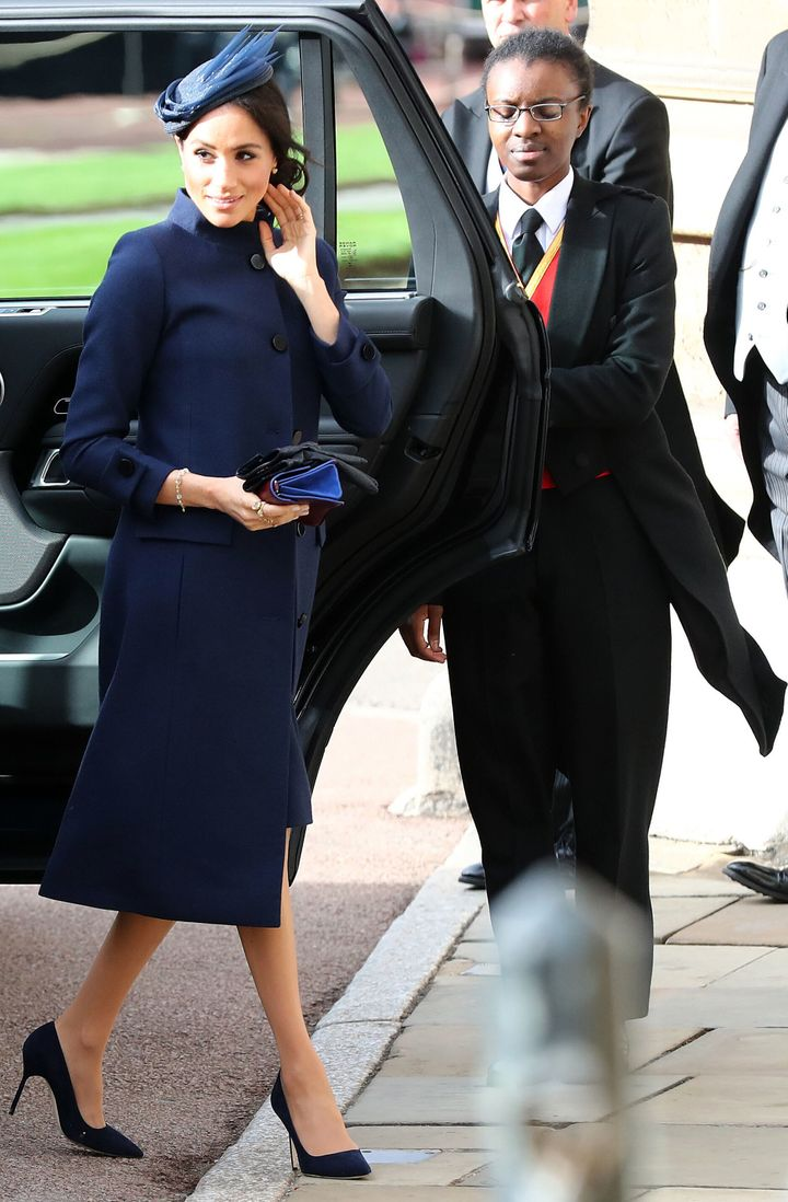 Meghan arrives to attend the wedding of Princess Eugenie of York to Jack Brooksbank at St George's Chapel, Windsor Castle, in Windsor last Friday. Check that navy coat!